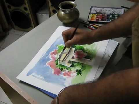 Dipping the brush in watercolor liquid