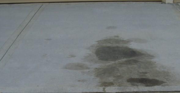 How to remove oil stains from concrete with coke for Clean oil off concrete